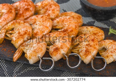 Paprika Prawn Satay - BBQ prawns on a skewer dusted with smoked paprika served on a slate. - stock photo
