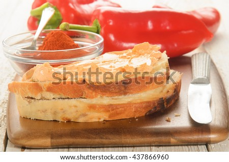 paprika spread on a slice of bread and ground powder  - stock photo