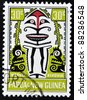 PAPUA NEW GUINEA - CIRCA 1966: A stamp printed in Papa New Guinea shows one of the myths of the Elema people, the legend of Meavea Kivovia and the Black Cockatoo, circa 1966 - stock photo