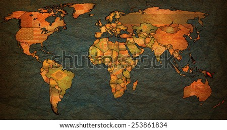 papua new guinea flag on old vintage world map with national borders - stock photo