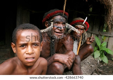 Papua New Guinea, Indonesia. May 6, 2007. Unidentified Papuans in traditional body painting and headdresses.