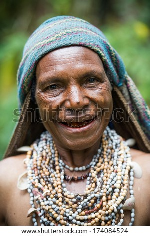 PAPUA, NEW GUINEA - OCTOBER 26: A woman of a Ji-Paiya-Kutumb Tribe of Papua New Guinea in traditional clothing on October 26, 2013.
