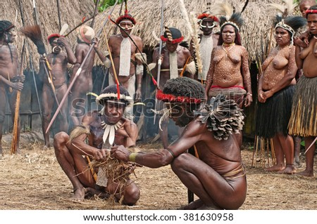PAPUA PROVINCE, INDONESIA -DEC 28: Unidentified members of a Papuan tribe at New Guinea Island, Indonesia on December 28, 2010