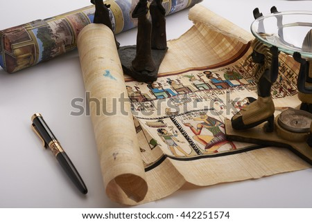 papyrus and candlesticks and pen - stock photo