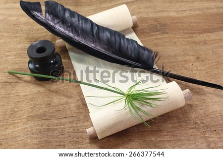Papyrus scroll with Papyrus plant, quill and inkwell