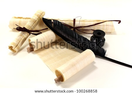 papyrus scrolls with pen and inkpot on a light background