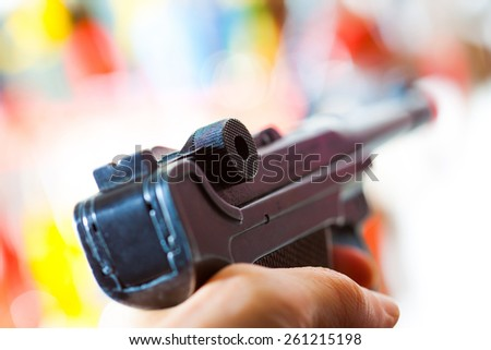 Parabellum automatic pistol in a hand, shallow depth of field. close-up - stock photo