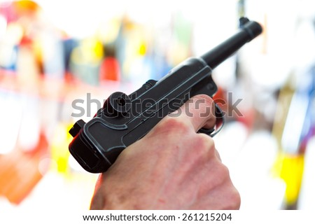 Parabellum automatic pistol in a human hand, shallow depth of field. close-up - stock photo