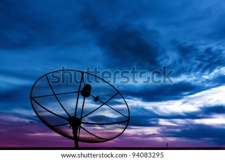 Parabolic satellite dish in twilight time with blue sky