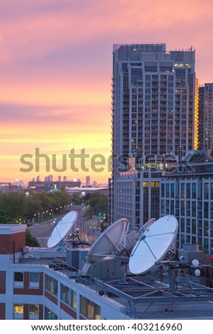Parabolic satellite dish space technology receivers over the city, Toronto, Canada. - stock photo