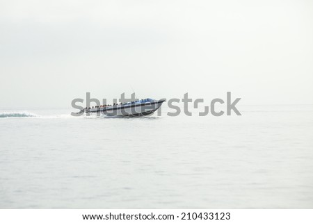 PARACAS -PERU CIRCA JULY 2014: A boat with tourists sailing on the sea on July 8, 2014 in Paracas. Tourist boats take people to Islas Ballestas every day to observe the animals in the national park