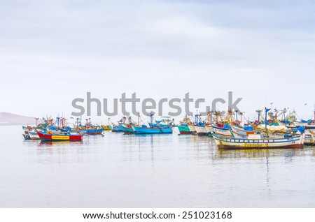 PARACAS, PERU, MAY 22, 2014: Boats moor in port of Paracas - stock photo