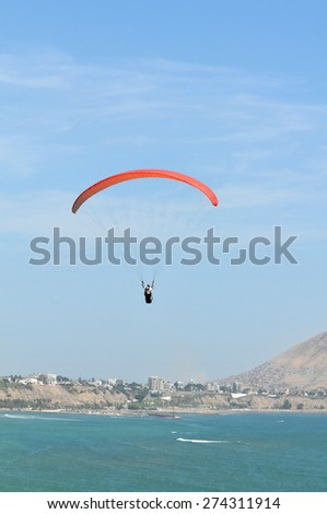 Parachute flying over the ocean in Lima , Peru - stock photo