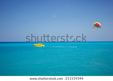 parachute on the high seas pulls powerboat/parachute on the high/parachute - stock photo