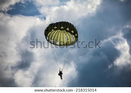 Parachutist in the war - stock photo