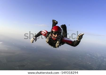 Parachutist prepares to open the parachute. - stock photo