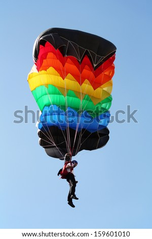 parachutist with colorful parachute extreme sport  - stock photo