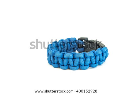 Paracord bracelet blue white background. - stock photo