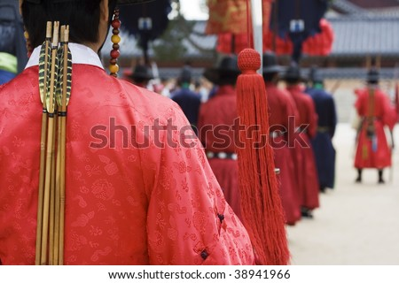 Parade at a Korean Palace for tourist.  Actors are dressed up in traditional costume to show how the emperor of Korea might've lived.