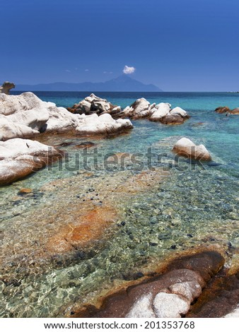 Paradise bay beach in Aegean sea, untouched nature abstract archipelago in seashore coastline with rocks in water on peninsula Halkidiki, Greece - stock photo