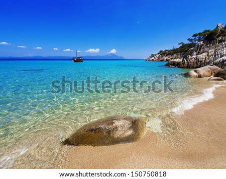 Paradise bay beach , Untouched nature abstract archipelago in seashore with rocks in water on peninsula Halkidiki, Greece  - stock photo