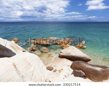 Paradise bay beach, untouched nature abstract archipelago in seashore with rocks in water on peninsula Halkidiki, Greece, relaxation landscape viewpoint for design postcard and calendar - stock photo