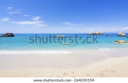 Paradise bay beach, untouched nature abstract archipelago in seashore with rocks in water on island Lefkada or Lefkas or Leukas, is a Greek island in the Ionian Sea on the west coast of Greece - stock photo