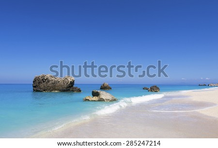 Paradise bay beach, untouched nature abstract archipelago in seashore with rocks in water on island Lefkada or Lefkas or Leukas, relaxation landscape viewpoint for design postcard and calendar - stock photo