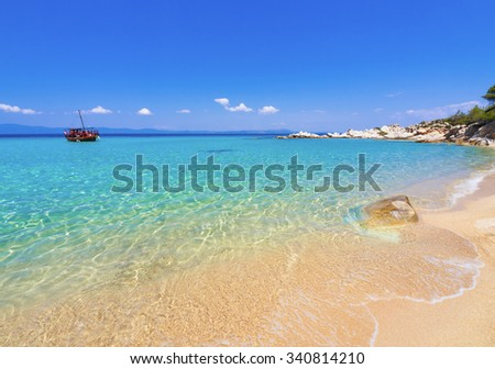 Paradise bay beach, untouched unique nature abstract archipelago on peninsula Halkidiki, Chalkidiki, Greece, with Sithonia, Atos, Kassandra. Relaxation landscape for design postcard and calendar - stock photo
