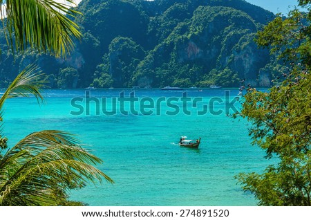 Paradise bay on Phi Phi Island with colorful long tail boats, Phuket, Thailand - stock photo