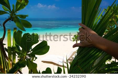 Paradise beach on an ocean island - stock photo