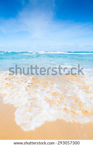 Paradise beach with blue sky and water and white sand. - stock photo