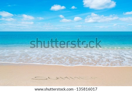 "paradise beach with ""summer"" written in sand"