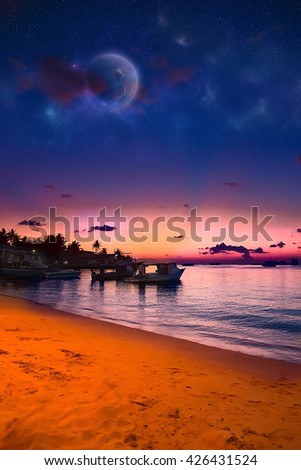 Paradise Maldives beach at pink sunset, glowing light in with  boats romantic place for honeymoon vacation, summer evening on exotic island, Maldives landscape - stock photo