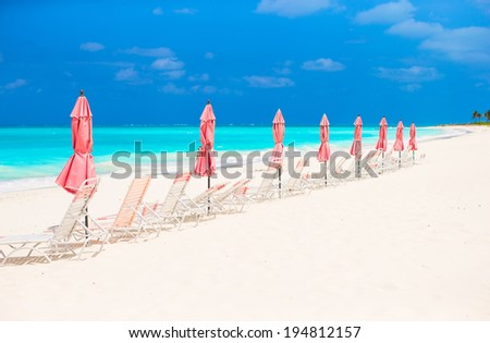 Paradise view of tropical empty sandy plage with umbrella and beach chair