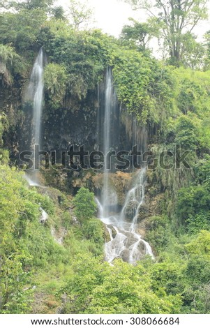 Paradise waterfall in Tropical rain forest of Thailand , water fall in deep forest at Tak province Thailand .The waterfall named Thararuk waterfall - stock photo