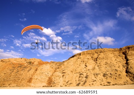 paraglider above a cliff - stock photo