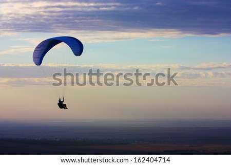 Paraglider flight in Crimea, Ukraine  - stock photo