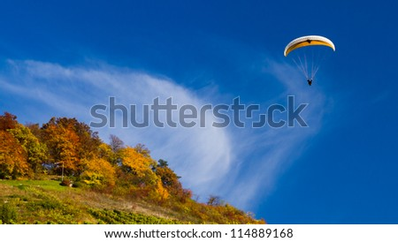 paraglider in autumn - stock photo
