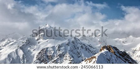 paraglider in the mountains, winter landscape