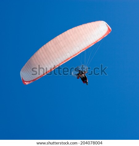 Paraglider on Blue Sky - stock photo