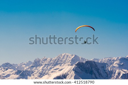 paraglider over the austrian alps - stock photo