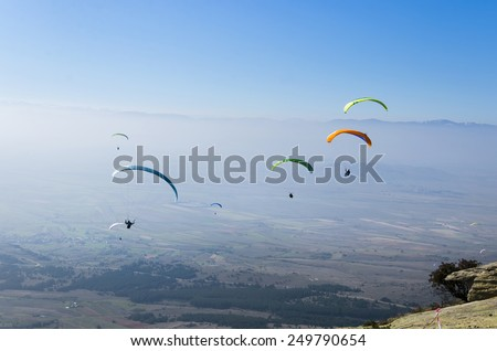 Paragliders show their amazing skill, extreme sport stock photo - stock photo