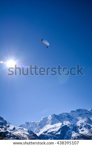 Paragliding above gimmelwald & murren villages near lauterbrunnen in Switzerland.