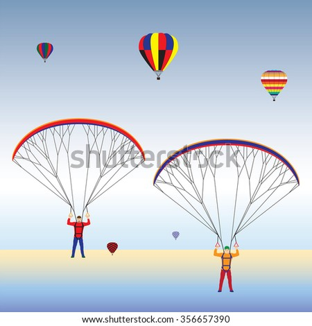 Paragliding and hot air balloons in the sky. Paraglider. Paraplane. Kite. Hot air balloon. - stock photo