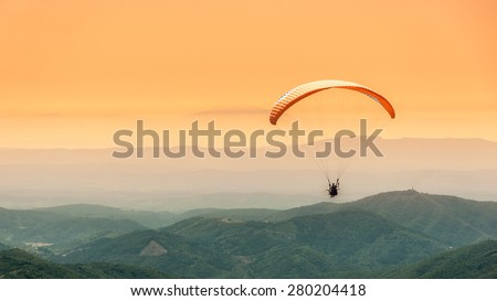 Paragliding flight - stock photo