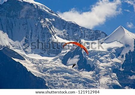 Paragliding in swiss alps Jungfrau region, Switzerland - stock photo