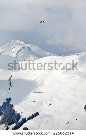 Paragliding in the Alps  - stock photo