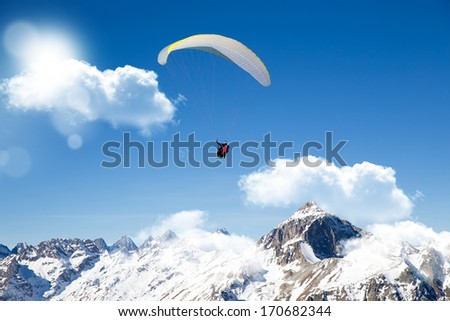 Paragliding in the blue sky - stock photo