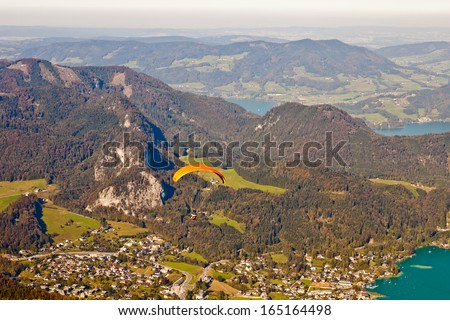 paragliding over mountains, St. Gilgen and  Wolfgangsee lake in austrian Alps - stock photo
